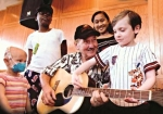 James Burton with patients at St. Jude Children's Research Hospital